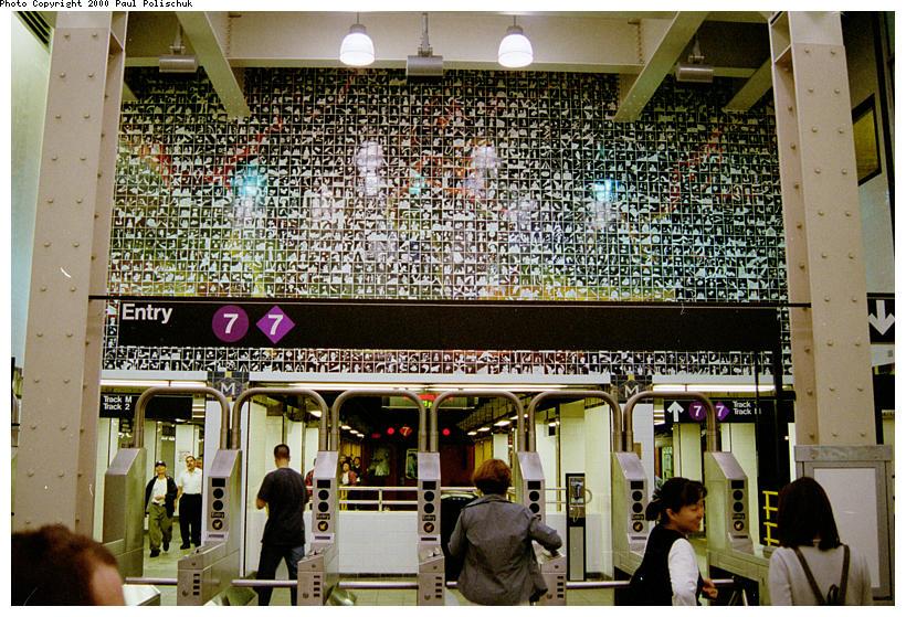 (152k, 820x559)<br><b>Country:</b> United States<br><b>City:</b> New York<br><b>System:</b> New York City Transit<br><b>Line:</b> IRT Flushing Line<br><b>Location:</b> Main Street/Flushing<br><b>Photo by:</b> Paul Polischuk<br><b>Date:</b> 5/17/2000<br><b>Artwork:</b> <i>Happy World</i>, Ik-Joong Kang, 1998<br><b>Viewed (this week/total):</b> 3 / 9865
