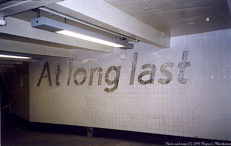 (59k, 748x473)<br><b>Country:</b> United States<br><b>City:</b> New York<br><b>System:</b> New York City Transit<br><b>Line:</b> IND 8th Avenue Line<br><b>Location:</b> 207th Street<br><b>Photo by:</b> Wayne Whitehorne<br><b>Date:</b> 9/24/1999<br><b>Artwork:</b> <i>At the Start... At Long Last</i>, Sheila Levrant de Bretteville, 1999<br><b>Viewed (this week/total):</b> 0 / 6417