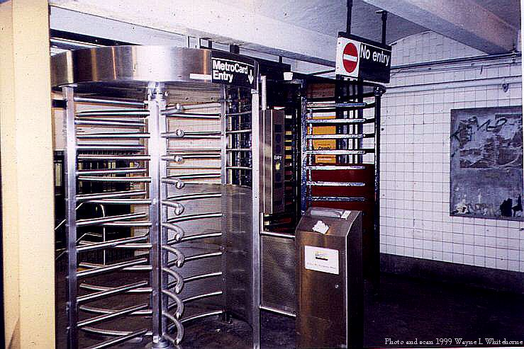 (94k, 739x493)<br><b>Country:</b> United States<br><b>City:</b> New York<br><b>System:</b> New York City Transit<br><b>Line:</b> IND 8th Avenue Line<br><b>Location:</b> 23rd Street<br><b>Photo by:</b> Wayne Whitehorne<br><b>Date:</b> 1/16/1999<br><b>Notes:</b> Metrocard iron maiden<br><b>Viewed (this week/total):</b> 1 / 4756