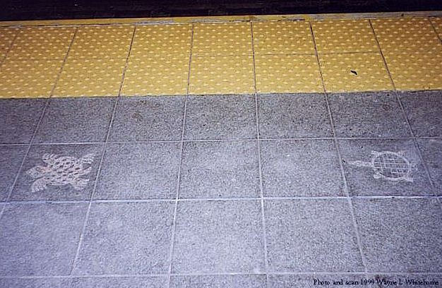 (72k, 626x408)<br><b>Country:</b> United States<br><b>City:</b> New York<br><b>System:</b> New York City Transit<br><b>Line:</b> IND 8th Avenue Line<br><b>Location:</b> 81st Street/Museum of Natural History<br><b>Photo by:</b> Wayne Whitehorne<br><b>Date:</b> 8/14/1999<br><b>Artwork:</b> <i>For Want of a Nail</i>, MTA Arts For Transit Collaborative, 1999<br><b>Notes:</b> Platform edge decorations<br><b>Viewed (this week/total):</b> 0 / 10025