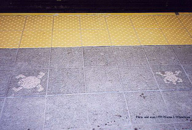 (71k, 626x422)<br><b>Country:</b> United States<br><b>City:</b> New York<br><b>System:</b> New York City Transit<br><b>Line:</b> IND 8th Avenue Line<br><b>Location:</b> 81st Street/Museum of Natural History<br><b>Photo by:</b> Wayne Whitehorne<br><b>Date:</b> 8/14/1999<br><b>Artwork:</b> <i>For Want of a Nail</i>, MTA Arts For Transit Collaborative, 1999<br><b>Notes:</b> Platform edge decorations<br><b>Viewed (this week/total):</b> 0 / 10065