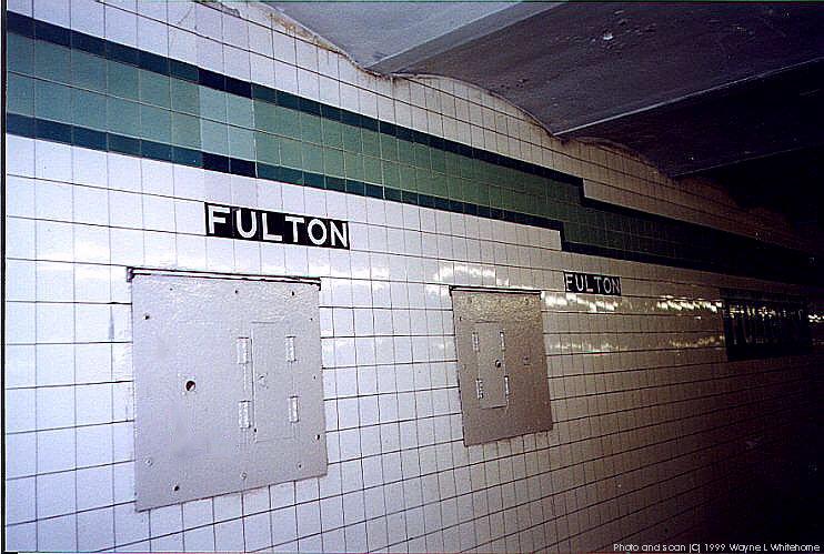 (92k, 742x499)<br><b>Country:</b> United States<br><b>City:</b> New York<br><b>System:</b> New York City Transit<br><b>Line:</b> IND Crosstown Line<br><b>Location:</b> Fulton Street<br><b>Photo by:</b> Wayne Whitehorne<br><b>Date:</b> 1/28/1999<br><b>Notes:</b> Wall tile<br><b>Viewed (this week/total):</b> 1 / 4178