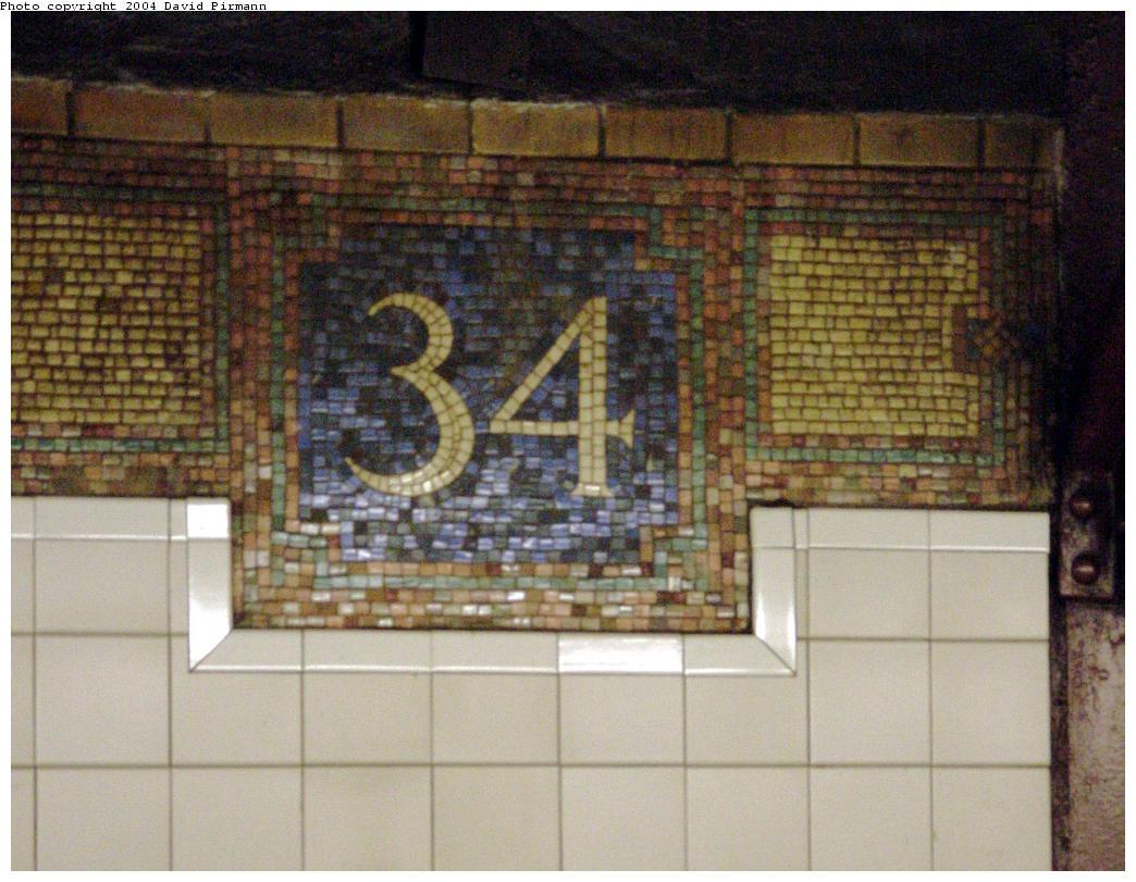 (131k, 1044x811)<br><b>Country:</b> United States<br><b>City:</b> New York<br><b>System:</b> New York City Transit<br><b>Line:</b> BMT Broadway Line<br><b>Location:</b> 34th Street/Herald Square<br><b>Photo by:</b> David Pirmann<br><b>Date:</b> 8/27/2000<br><b>Notes:</b> Renovated wall tiling and original BMT 34 monogram<br><b>Viewed (this week/total):</b> 0 / 3986