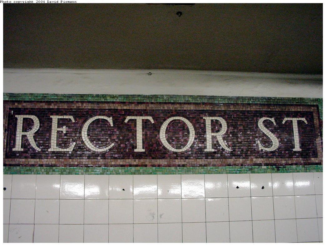 (134k, 1044x788)<br><b>Country:</b> United States<br><b>City:</b> New York<br><b>System:</b> New York City Transit<br><b>Line:</b> BMT Broadway Line<br><b>Location:</b> Rector Street<br><b>Photo by:</b> David Pirmann<br><b>Date:</b> 8/27/2000<br><b>Notes:</b> Last remaining mosaic name tablet on northbound platform<br><b>Viewed (this week/total):</b> 0 / 3776