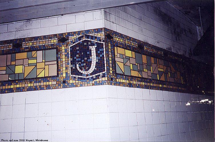 (100k, 752x496)<br><b>Country:</b> United States<br><b>City:</b> New York<br><b>System:</b> New York City Transit<br><b>Line:</b> BMT Canarsie Line<br><b>Location:</b> Jefferson Street<br><b>Route:</b> L<br><b>Photo by:</b> Wayne Whitehorne<br><b>Date:</b> 9/2/2000<br><b>Notes:</b> New tile at Jefferson Street-corner icon and frieze<br><b>Viewed (this week/total):</b> 0 / 3370