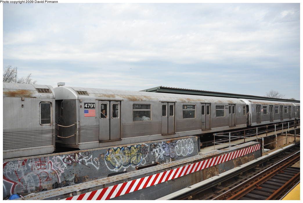(239k, 1044x701)<br><b>Country:</b> United States<br><b>City:</b> New York<br><b>System:</b> New York City Transit<br><b>Line:</b> BMT Nassau Street-Jamaica Line<br><b>Location:</b> Woodhaven Boulevard<br><b>Route:</b> J<br><b>Car:</b> R-42 (St. Louis, 1969-1970) 4791 <br><b>Photo by:</b> David Pirmann<br><b>Date:</b> 4/10/2009<br><b>Viewed (this week/total):</b> 2 / 1401