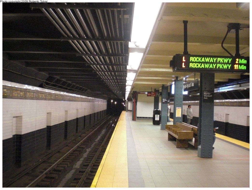 (252k, 1044x788)<br><b>Country:</b> United States<br><b>City:</b> New York<br><b>System:</b> New York City Transit<br><b>Line:</b> BMT Canarsie Line<br><b>Location:</b> Myrtle Avenue<br><b>Photo by:</b> Roberto C. Tobar<br><b>Date:</b> 4/11/2009<br><b>Notes:</b> Platform view; note new train arrival indicator signs.<br><b>Viewed (this week/total):</b> 1 / 2834