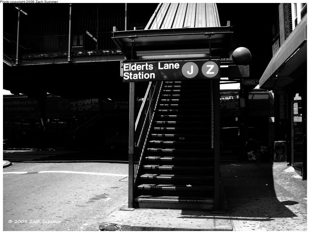 (196k, 1044x788)<br><b>Country:</b> United States<br><b>City:</b> New York<br><b>System:</b> New York City Transit<br><b>Line:</b> BMT Nassau Street-Jamaica Line<br><b>Location:</b> 75th Street/Elderts Lane<br><b>Photo by:</b> Zach Summer<br><b>Date:</b> 6/6/2009<br><b>Notes:</b> Station entrance.<br><b>Viewed (this week/total):</b> 1 / 2154