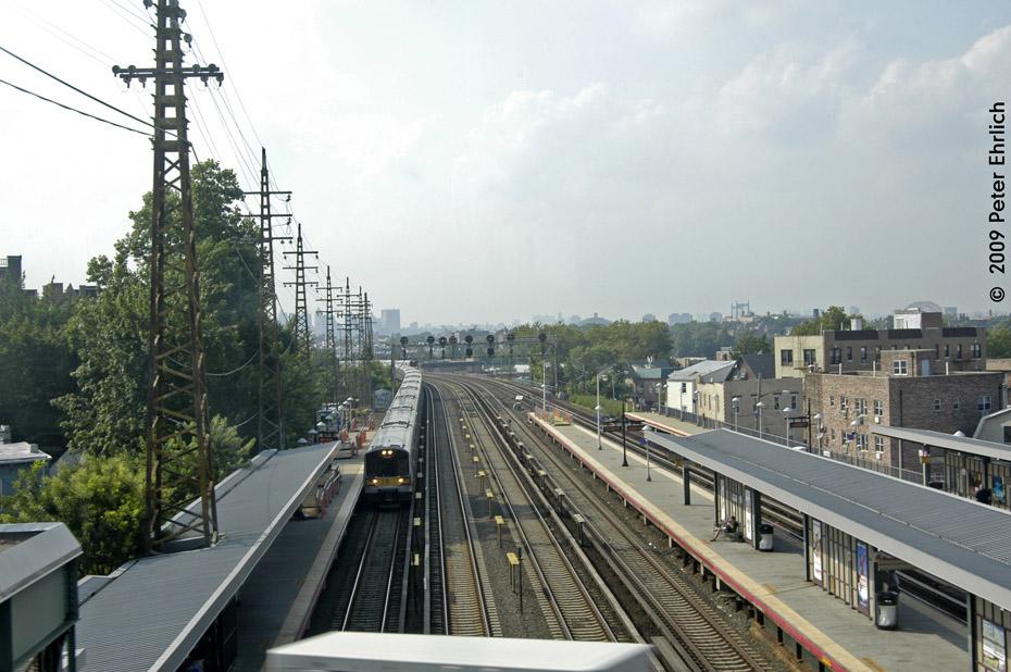 (205k, 930x618)<br><b>Country:</b> United States<br><b>City:</b> New York<br><b>System:</b> Long Island Rail Road<br><b>Line:</b> LIRR Main Line<br><b>Location:</b> Woodside<br><b>Car:</b> LIRR M-7 EMU (Bombardier) 7260 <br><b>Photo by:</b> Peter Ehrlich<br><b>Date:</b> 7/22/2009<br><b>Notes:</b> Outbound<br><b>Viewed (this week/total):</b> 0 / 633