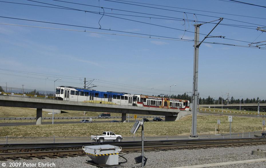 (184k, 930x590)<br><b>Country:</b> United States<br><b>City:</b> Portland, OR<br><b>System:</b> Portland MAX<br><b>Line:</b> MAX Blue (East-West) Line<br><b>Location:</b> NE 99th/Gateway Transit Center<br><b>Car:</b> MAX Type 1 (Bombardier) 120 <br><b>Photo by:</b> Peter Ehrlich<br><b>Date:</b> 9/15/2009<br><b>Notes:</b> Inbound from Airport.<br><b>Viewed (this week/total):</b> 0 / 496