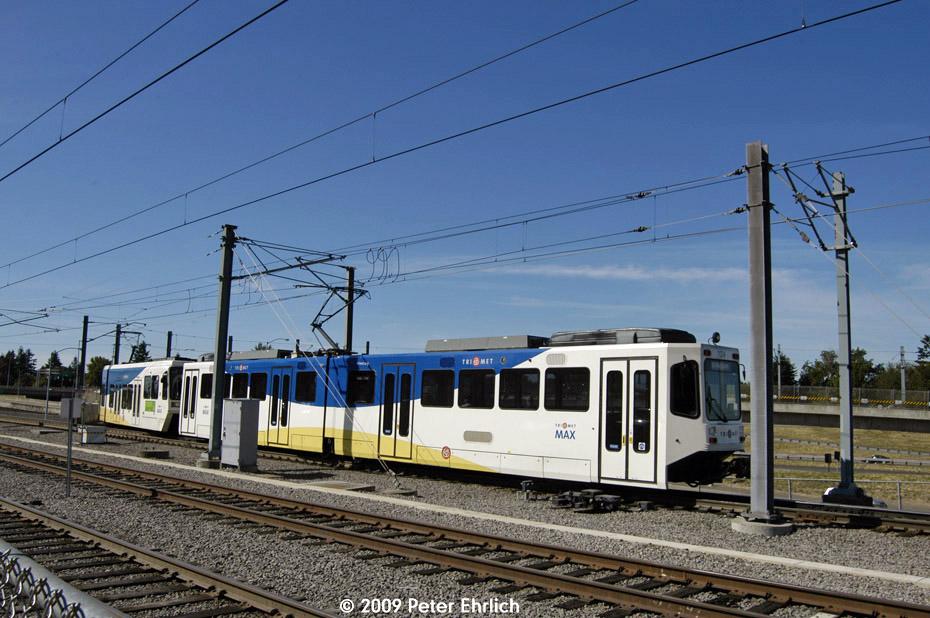 (207k, 930x618)<br><b>Country:</b> United States<br><b>City:</b> Portland, OR<br><b>System:</b> Portland MAX<br><b>Line:</b> MAX Blue (East-West) Line<br><b>Location:</b> NE 99th/Gateway Transit Center<br><b>Car:</b> MAX Type 1 (Bombardier) 124 <br><b>Photo by:</b> Peter Ehrlich<br><b>Date:</b> 9/15/2009<br><b>Notes:</b> Outbound.<br><b>Viewed (this week/total):</b> 1 / 740