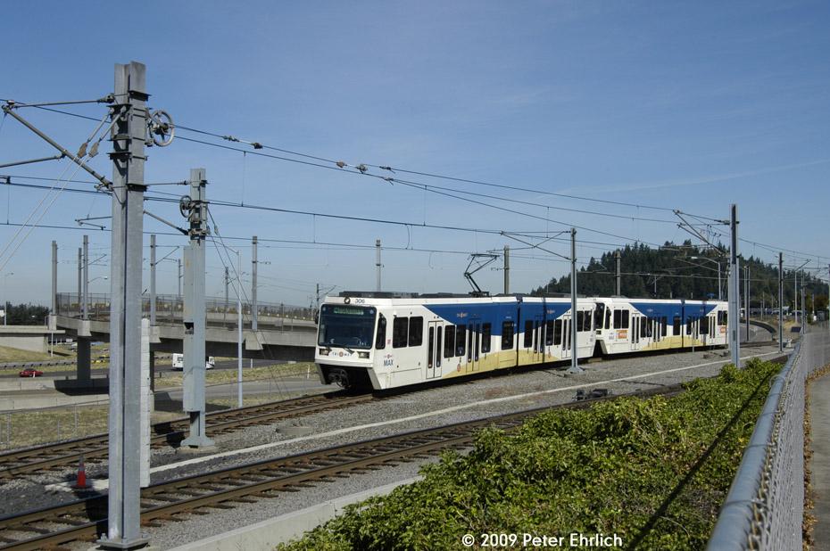 (216k, 930x618)<br><b>Country:</b> United States<br><b>City:</b> Portland, OR<br><b>System:</b> Portland MAX<br><b>Line:</b> MAX Blue (East-West) Line<br><b>Location:</b> NE 99th/Gateway Transit Center<br><b>Car:</b> MAX Type 3 (Siemens SD600A) 306 <br><b>Photo by:</b> Peter Ehrlich<br><b>Date:</b> 9/15/2009<br><b>Notes:</b> Outbound.<br><b>Viewed (this week/total):</b> 0 / 501
