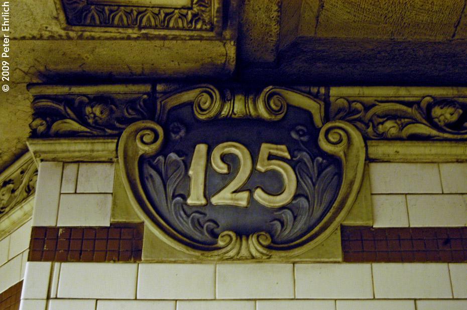 (264k, 930x618)<br><b>Country:</b> United States<br><b>City:</b> New York<br><b>System:</b> New York City Transit<br><b>Line:</b> IRT Lenox Avenue Line<br><b>Location:</b> 125th Street<br><b>Photo by:</b> Peter Ehrlich<br><b>Date:</b> 10/9/2009<br><b>Notes:</b> Tilework.<br><b>Viewed (this week/total):</b> 1 / 1367