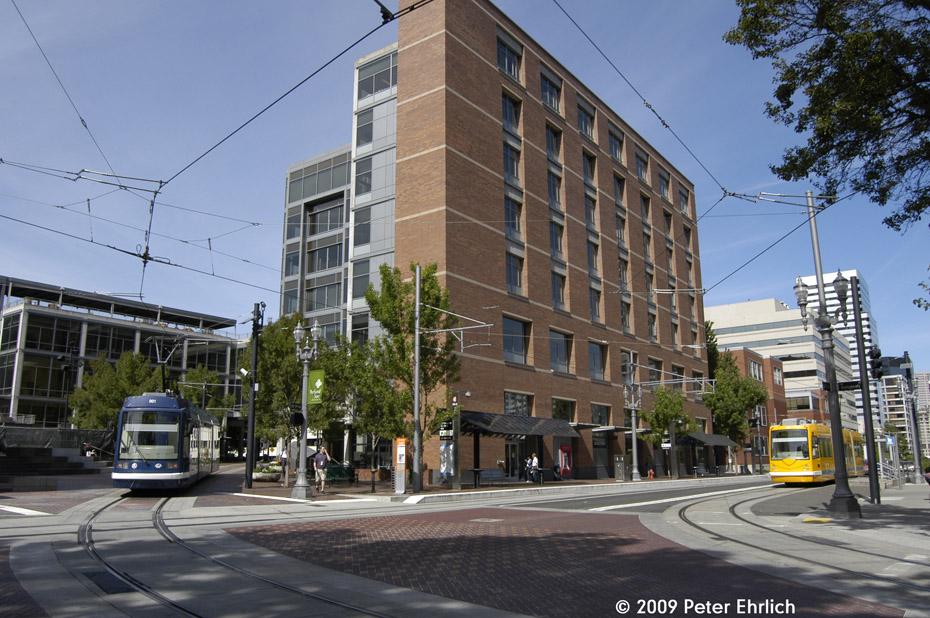 (237k, 930x618)<br><b>Country:</b> United States<br><b>City:</b> Portland, OR<br><b>System:</b> Portland Streetcar<br><b>Location:</b> Portland State Urban Center<br><b>Car:</b> Škoda/Inekon Astra 10T 001 <br><b>Photo by:</b> Peter Ehrlich<br><b>Date:</b> 9/15/2009<br><b>Notes:</b> Outbound. Approaching PSU outbound, trailing view.  With 010 inbound.<br><b>Viewed (this week/total):</b> 1 / 745