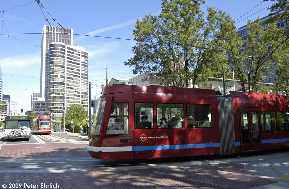(276k, 930x610)<br><b>Country:</b> United States<br><b>City:</b> Portland, OR<br><b>System:</b> Portland Streetcar<br><b>Location:</b> SW 5th/Montgomery<br><b>Car:</b> Škoda/Inekon Astra 10T 004 <br><b>Photo by:</b> Peter Ehrlich<br><b>Date:</b> 9/15/2009<br><b>Notes:</b> Outbound. With 007 inbound.<br><b>Viewed (this week/total):</b> 0 / 736