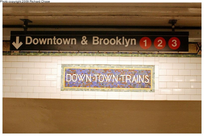 (101k, 820x547)<br><b>Country:</b> United States<br><b>City:</b> New York<br><b>System:</b> New York City Transit<br><b>Line:</b> IRT West Side Line<br><b>Location:</b> 34th Street/Penn Station<br><b>Photo by:</b> Richard Chase<br><b>Date:</b> 10/28/2009<br><b>Notes:</b> Downtown mosaic and signage.<br><b>Viewed (this week/total):</b> 0 / 1369