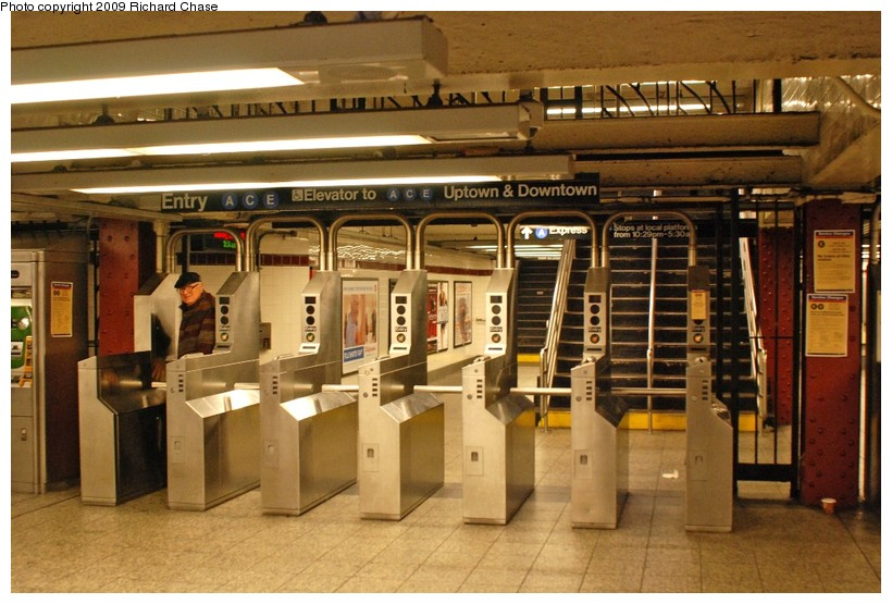 (135k, 820x555)<br><b>Country:</b> United States<br><b>City:</b> New York<br><b>System:</b> New York City Transit<br><b>Line:</b> IND 8th Avenue Line<br><b>Location:</b> 34th Street/Penn Station<br><b>Photo by:</b> Richard Chase<br><b>Date:</b> 10/12/2009<br><b>Notes:</b> Turnstiles.<br><b>Viewed (this week/total):</b> 1 / 2185