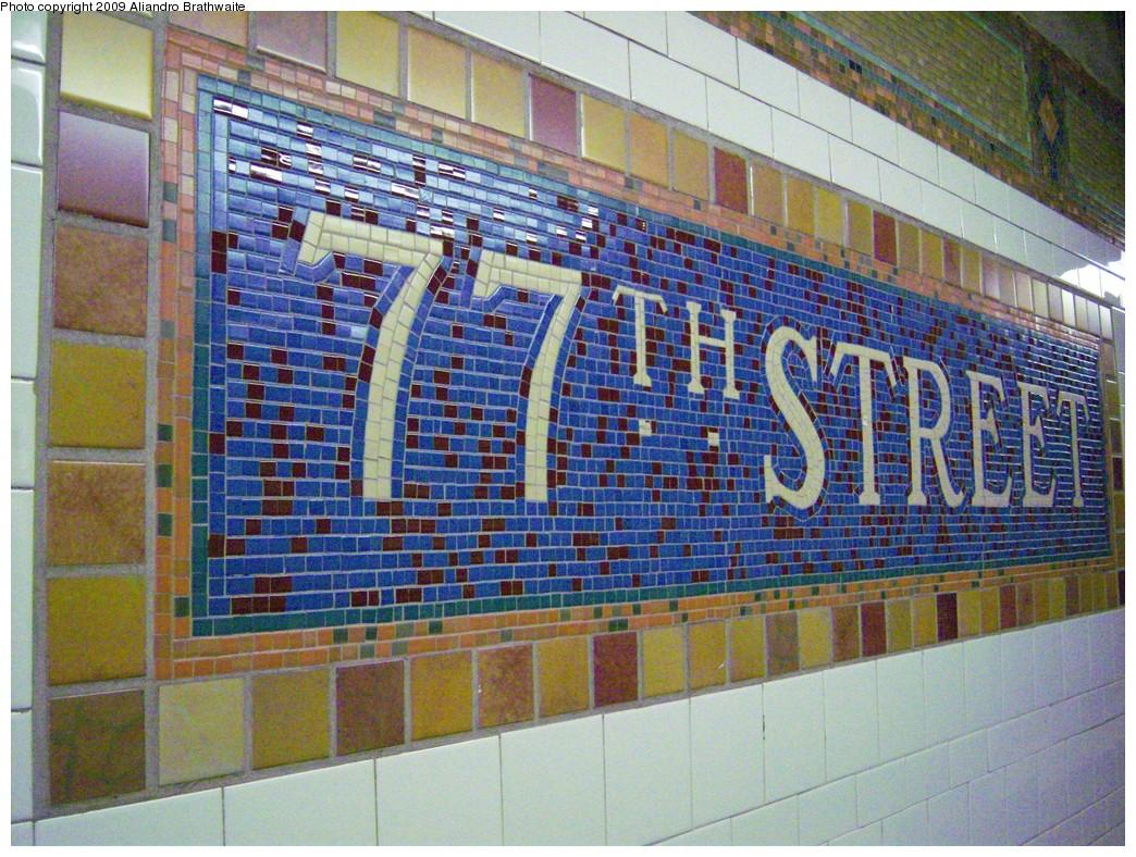 (321k, 1044x788)<br><b>Country:</b> United States<br><b>City:</b> New York<br><b>System:</b> New York City Transit<br><b>Line:</b> IRT East Side Line<br><b>Location:</b> 77th Street<br><b>Photo by:</b> Aliandro Brathwaite<br><b>Date:</b> 8/31/2009<br><b>Notes:</b> Mosaic name tile closeup<br><b>Viewed (this week/total):</b> 0 / 1357