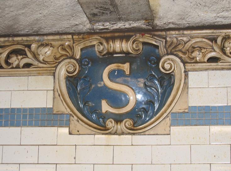 (73k, 735x544)<br><b>Country:</b> United States<br><b>City:</b> New York<br><b>System:</b> New York City Transit<br><b>Line:</b> IRT East Side Line<br><b>Location:</b> Spring Street<br><b>Photo by:</b> Robbie Rosenfeld<br><b>Date:</b> 3/1/2005<br><b>Notes:</b> Terra-cotta plaque, Heins & LaFarge/Atlantic Terra Cotta Company, 1904. Original design element, Contract 1 IRT.<br><b>Viewed (this week/total):</b> 2 / 5469