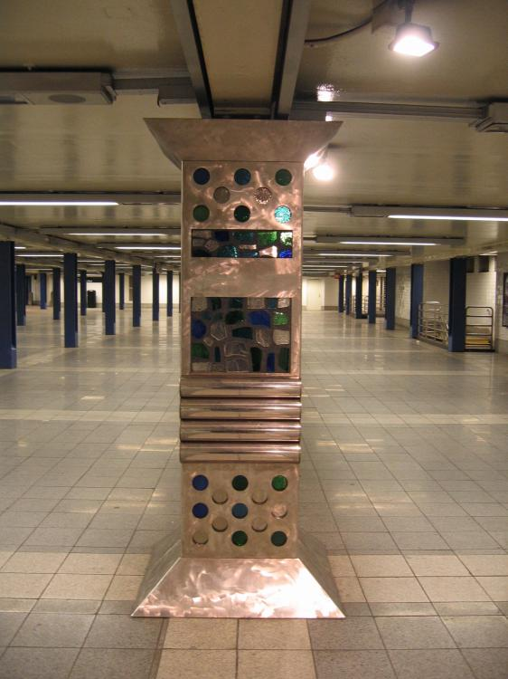 (63k, 562x750)<br><b>Country:</b> United States<br><b>City:</b> New York<br><b>System:</b> New York City Transit<br><b>Line:</b> IND Queens Boulevard Line<br><b>Location:</b> Woodhaven Boulevard/Queens Mall<br><b>Photo by:</b> Robbie Rosenfeld<br><b>Date:</b> 3/14/2005<br><b>Artwork:</b> <i>In Memory of the Lost Battalion</i>, Pablo Tauler, 1996<br><b>Viewed (this week/total):</b> 1 / 4621