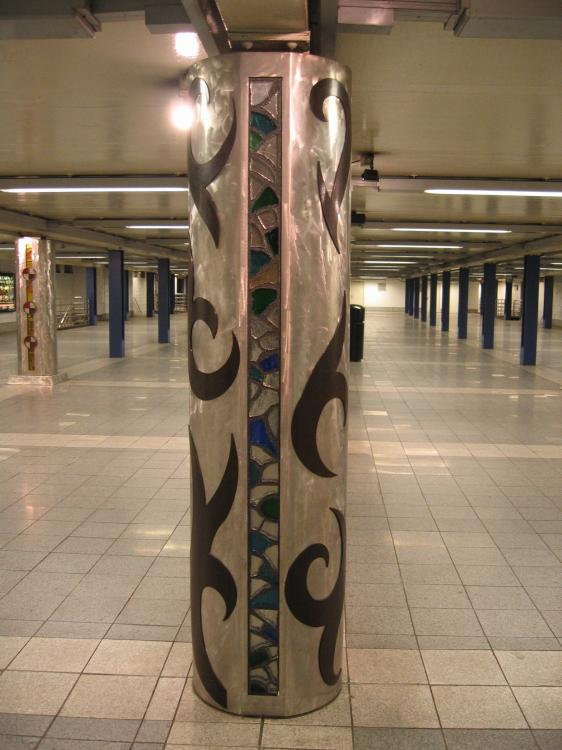 (65k, 562x750)<br><b>Country:</b> United States<br><b>City:</b> New York<br><b>System:</b> New York City Transit<br><b>Line:</b> IND Queens Boulevard Line<br><b>Location:</b> Woodhaven Boulevard/Queens Mall<br><b>Photo by:</b> Robbie Rosenfeld<br><b>Date:</b> 3/14/2005<br><b>Artwork:</b> <i>In Memory of the Lost Battalion</i>, Pablo Tauler, 1996<br><b>Viewed (this week/total):</b> 0 / 4080