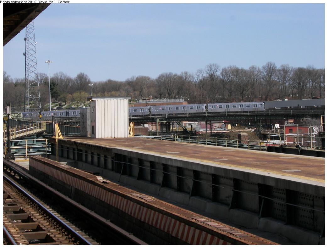 (262k, 1044x788)<br><b>Country:</b> United States<br><b>City:</b> New York<br><b>System:</b> New York City Transit<br><b>Line:</b> BMT Canarsie Line<br><b>Location:</b> Atlantic Avenue<br><b>Photo by:</b> David-Paul Gerber<br><b>Date:</b> 4/3/2010<br><b>Notes:</b> Platform view with J train in distance<br><b>Viewed (this week/total):</b> 0 / 1627