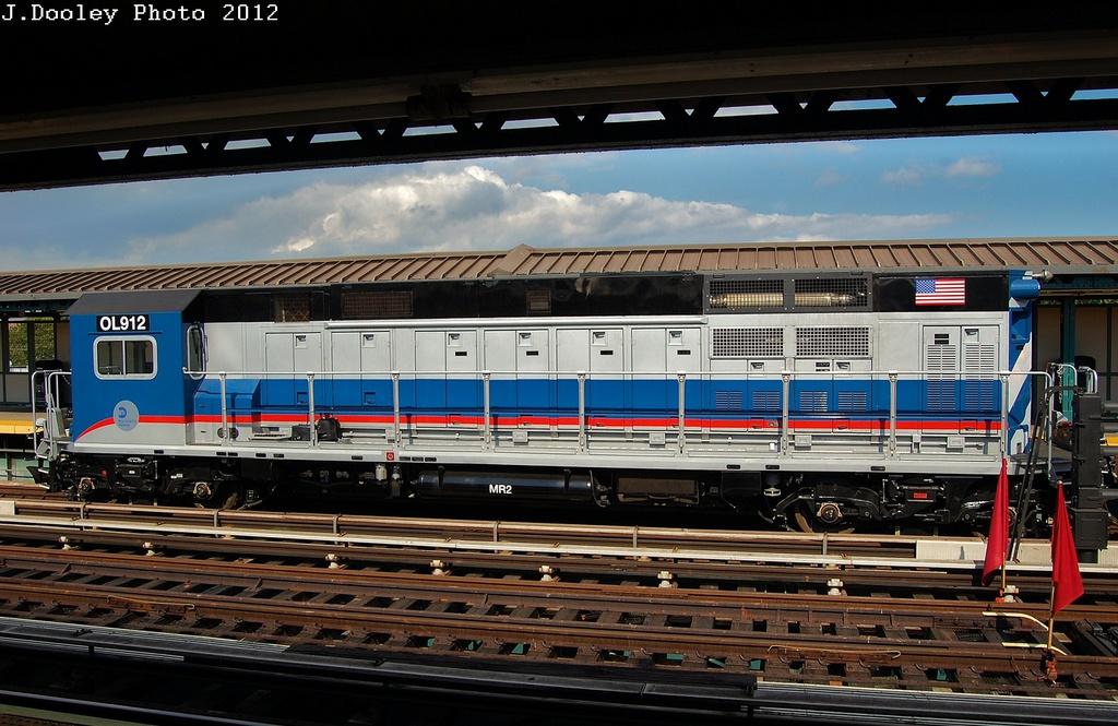 (328k, 1024x665)<br><b>Country:</b> United States<br><b>City:</b> New York<br><b>System:</b> New York City Transit<br><b>Line:</b> BMT West End Line<br><b>Location:</b> Bay 50th Street<br><b>Route:</b> Work Service<br><b>Car:</b> R-156 Diesel-Electric Locomotive (MPI, 2012-2013) 912 <br><b>Photo by:</b> John Dooley<br><b>Date:</b> 7/29/2012<br><b>Viewed (this week/total):</b> 0 / 1876