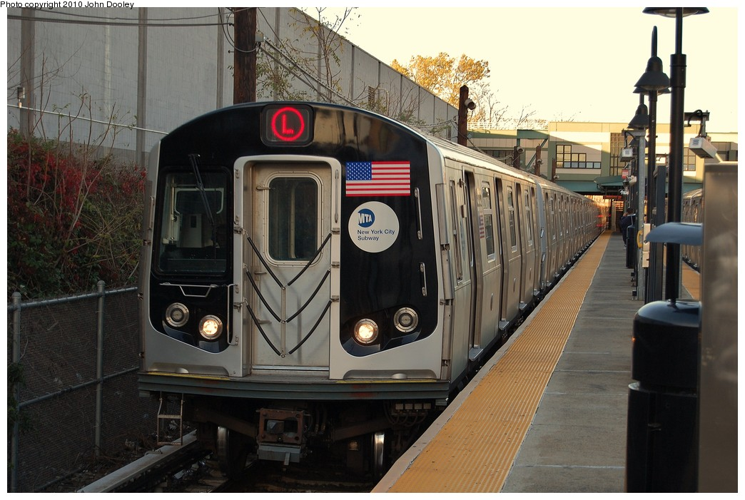 (237k, 1044x701)<br><b>Country:</b> United States<br><b>City:</b> New York<br><b>System:</b> New York City Transit<br><b>Line:</b> BMT Canarsie Line<br><b>Location:</b> East 105th Street<br><b>Route:</b> L<br><b>Car:</b> R-143 (Kawasaki, 2001-2002) 8313 <br><b>Photo by:</b> John Dooley<br><b>Date:</b> 10/28/2010<br><b>Viewed (this week/total):</b> 1 / 1629