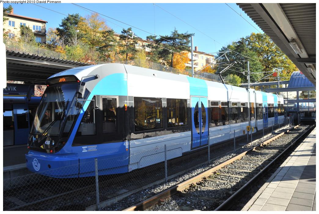 (334k, 1044x701)<br><b>Country:</b> Sweden<br><b>City:</b> Stockholm<br><b>System:</b> Storstockholms Lokaltrafik<br><b>Line:</b> Nockebybanan<br><b>Location:</b> Alvik<br><b>Car:</b> Flexity Swift SL Class A32 (Adtranz/Bombardier, 1999-2009) 430 <br><b>Photo by:</b> David Pirmann<br><b>Date:</b> 10/14/2010<br><b>Notes:</b> Tram on inbound platform at Alvik.<br><b>Viewed (this week/total):</b> 2 / 1023