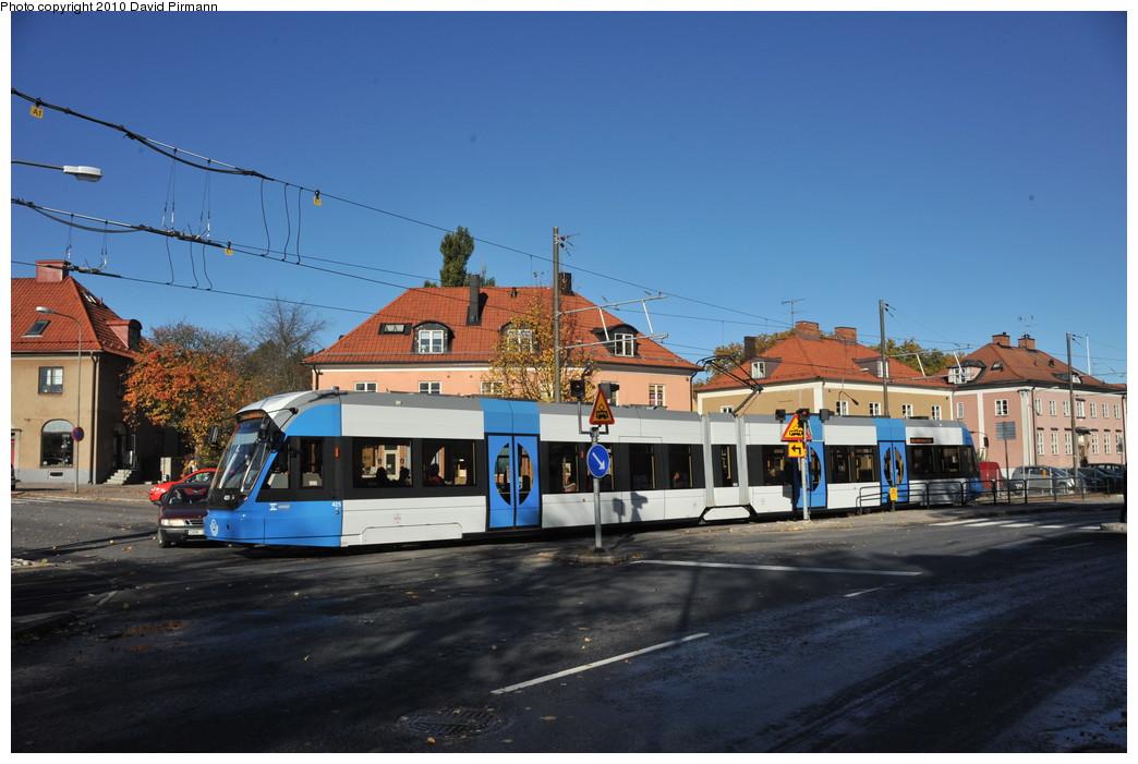 (238k, 1044x701)<br><b>Country:</b> Sweden<br><b>City:</b> Stockholm<br><b>System:</b> Storstockholms Lokaltrafik<br><b>Line:</b> Nockebybanan<br><b>Location:</b> Alléparken<br><b>Car:</b> Flexity Swift SL Class A32 (Adtranz/Bombardier, 1999-2009) 425 <br><b>Photo by:</b> David Pirmann<br><b>Date:</b> 10/14/2010<br><b>Notes:</b> Outbound tram in the crossover. Note the crossing catenary wire.<br><b>Viewed (this week/total):</b> 2 / 1100