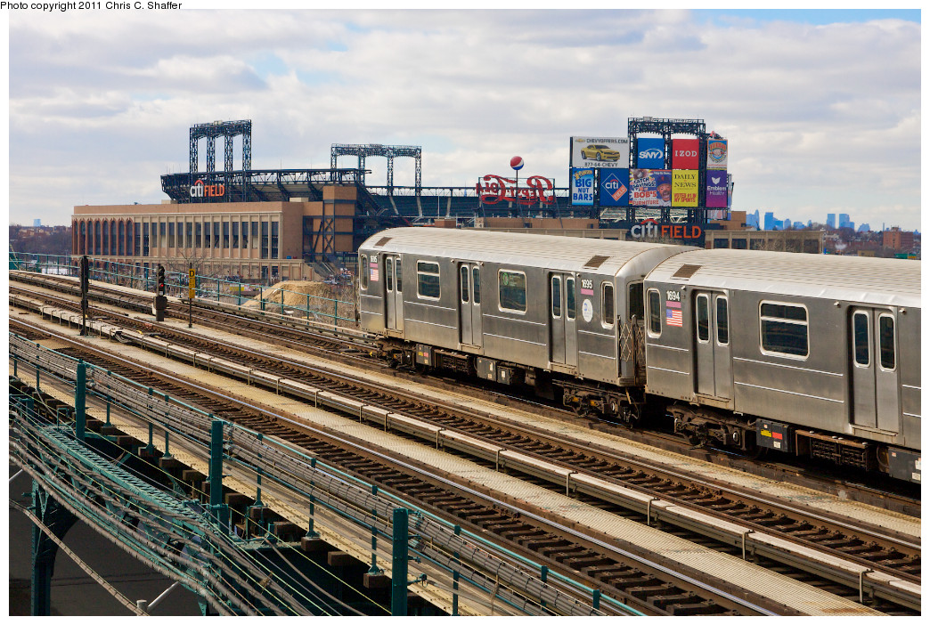 (342k, 1044x702)<br><b>Country:</b> United States<br><b>City:</b> New York<br><b>System:</b> New York City Transit<br><b>Line:</b> IRT Flushing Line<br><b>Location:</b> Main St. Tunnel Portal<br><b>Route:</b> 7<br><b>Car:</b> R-62A (Bombardier, 1984-1987) 1695 <br><b>Photo by:</b> Chris C. Shaffer<br><b>Date:</b> 2/8/2011<br><b>Notes:</b> View from Roosevelt Ave & College Point Blvd.<br><b>Viewed (this week/total):</b> 2 / 1697