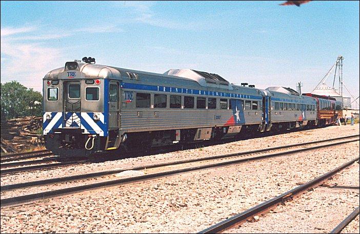 (114k, 702x457)<br><b>Country:</b> United States<br><b>City:</b> Dallas, TX<br><b>System:</b> Trinity Railway Express<br><b>Location:</b> Frisco, TX.<br><b>Photo by:</b> Jim Cumbie<br><b>Date:</b> 9/7/2003<br><b>Notes:</b> TRE RDCs and Denver Rail Car in Frisco, TX.<br><b>Viewed (this week/total):</b> 0 / 3330