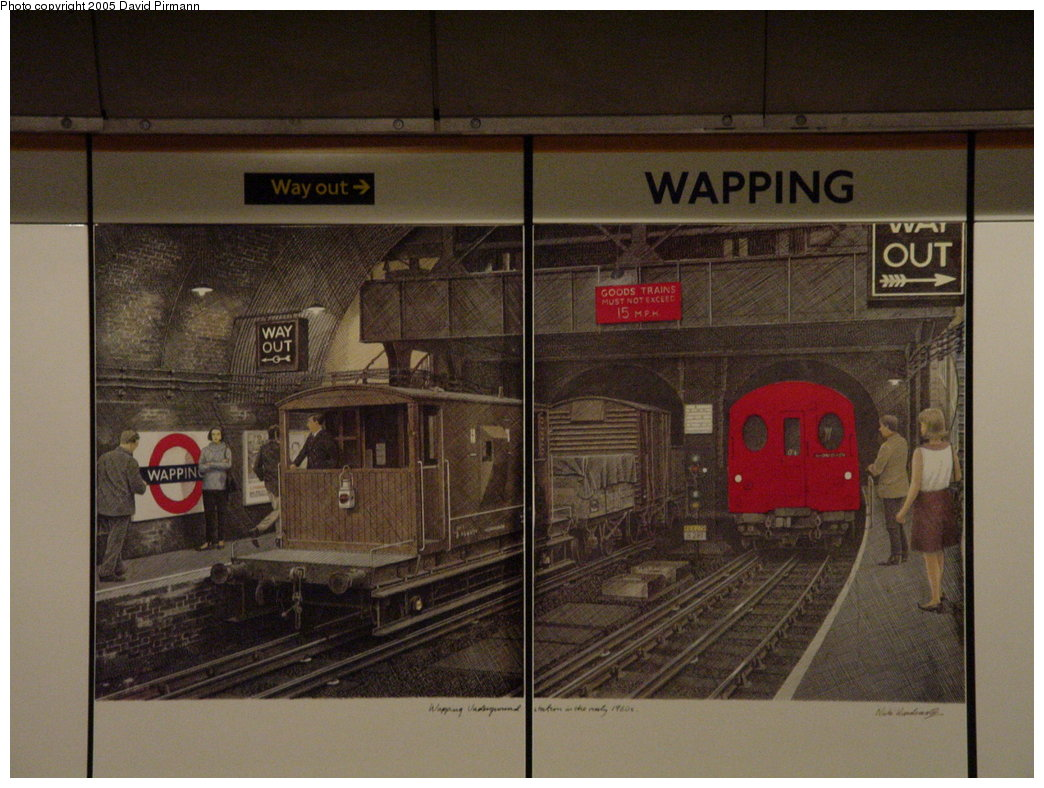 (173k, 1044x788)<br><b>Country:</b> United Kingdom<br><b>City:</b> London<br><b>System:</b> London Underground<br><b>Line:</b> East London<br><b>Location:</b> Wapping<br><b>Photo by:</b> David Pirmann<br><b>Date:</b> 4/21/2000<br><b>Notes:</b> Station artwork by artist Nick Hardcastle.<br><b>Viewed (this week/total):</b> 2 / 4842