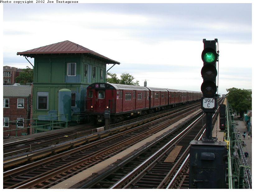 (117k, 820x620)<br><b>Country:</b> United States<br><b>City:</b> New York<br><b>System:</b> New York City Transit<br><b>Line:</b> IRT Flushing Line<br><b>Location:</b> 103rd Street/Corona Plaza<br><b>Route:</b> 7<br><b>Car:</b> R-36 Main Line (St. Louis, 1964) 9542 <br><b>Photo by:</b> Joe Testagrose<br><b>Date:</b> 6/4/2002<br><b>Viewed (this week/total):</b> 2 / 4161