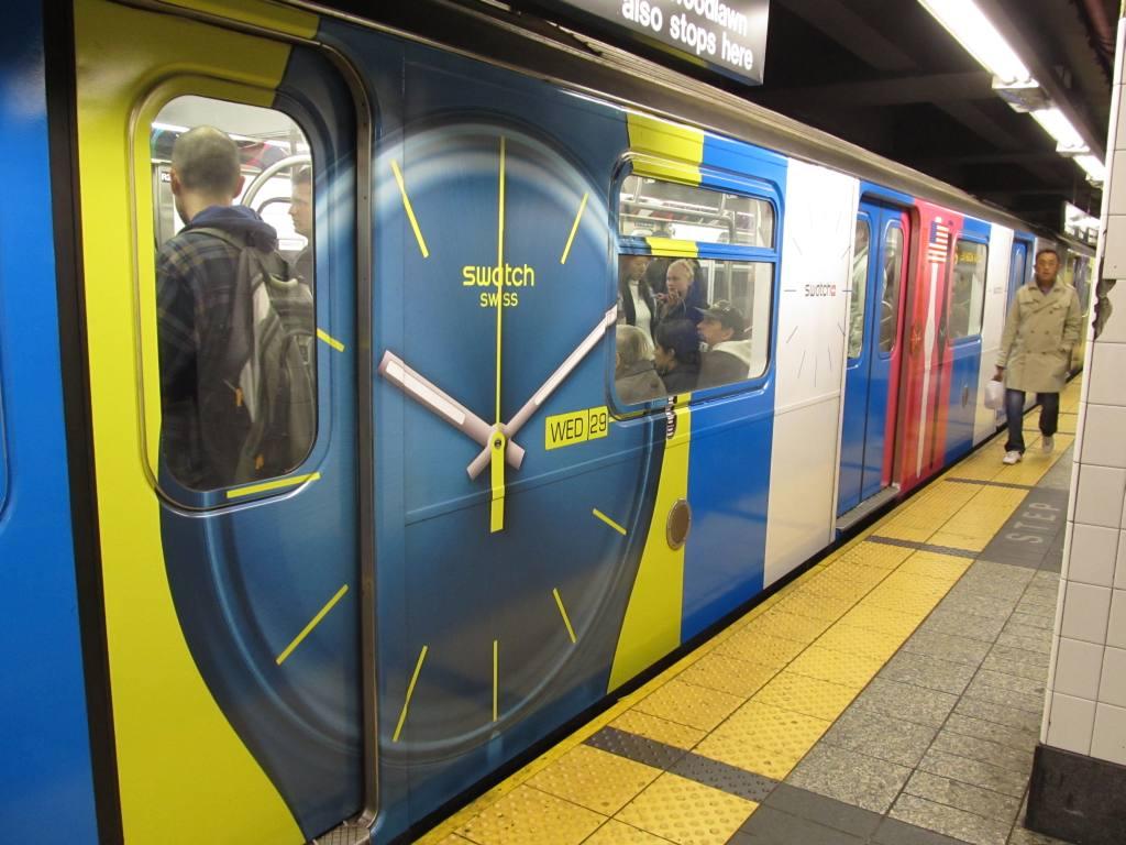 (112k, 1024x768)<br><b>Country:</b> United States<br><b>City:</b> New York<br><b>System:</b> New York City Transit<br><b>Line:</b> IRT East Side Line<br><b>Location:</b> Grand Central<br><b>Route:</b> 6<br><b>Car:</b> R-142 or R-142A (Number Unknown)  <br><b>Photo by:</b> Robbie Rosenfeld<br><b>Date:</b> 4/6/2011<br><b>Notes:</b> Swatch ad wrap.<br><b>Viewed (this week/total):</b> 2 / 1555