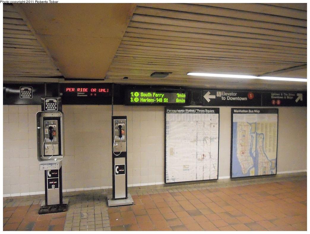 (252k, 1044x788)<br><b>Country:</b> United States<br><b>City:</b> New York<br><b>System:</b> New York City Transit<br><b>Line:</b> IRT West Side Line<br><b>Location:</b> 34th Street/Penn Station<br><b>Photo by:</b> Roberto C. Tobar<br><b>Date:</b> 4/8/2011<br><b>Notes:</b> Countdown signs in lower passageway.<br><b>Viewed (this week/total):</b> 8 / 1665