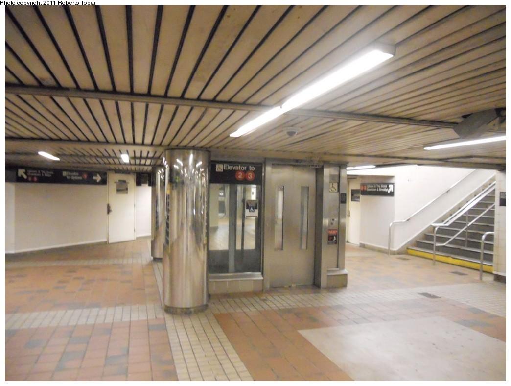 (211k, 1044x788)<br><b>Country:</b> United States<br><b>City:</b> New York<br><b>System:</b> New York City Transit<br><b>Line:</b> IRT West Side Line<br><b>Location:</b> 34th Street/Penn Station<br><b>Photo by:</b> Roberto C. Tobar<br><b>Date:</b> 4/8/2011<br><b>Notes:</b> Elevator in lower passageway.<br><b>Viewed (this week/total):</b> 3 / 1425