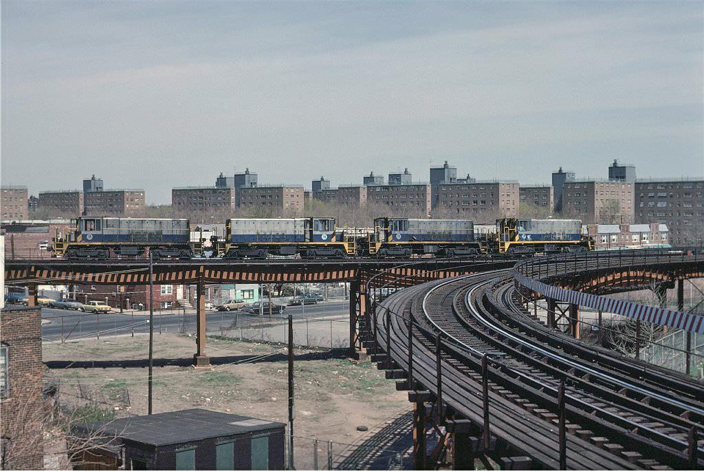 (314k, 1024x685)<br><b>Country:</b> United States<br><b>City:</b> New York<br><b>System:</b> New York City Transit<br><b>Line:</b> BMT West End Line<br><b>Location:</b> Bay 50th Street<br><b>Route:</b> Work Service<br><b>Car:</b> R-47 Locomotive 64 <br><b>Photo by:</b> Joe Testagrose<br><b>Date:</b> 4/16/1977<br><b>Notes:</b> Left to right, 64/68/70/69<br><b>Viewed (this week/total):</b> 1 / 1763
