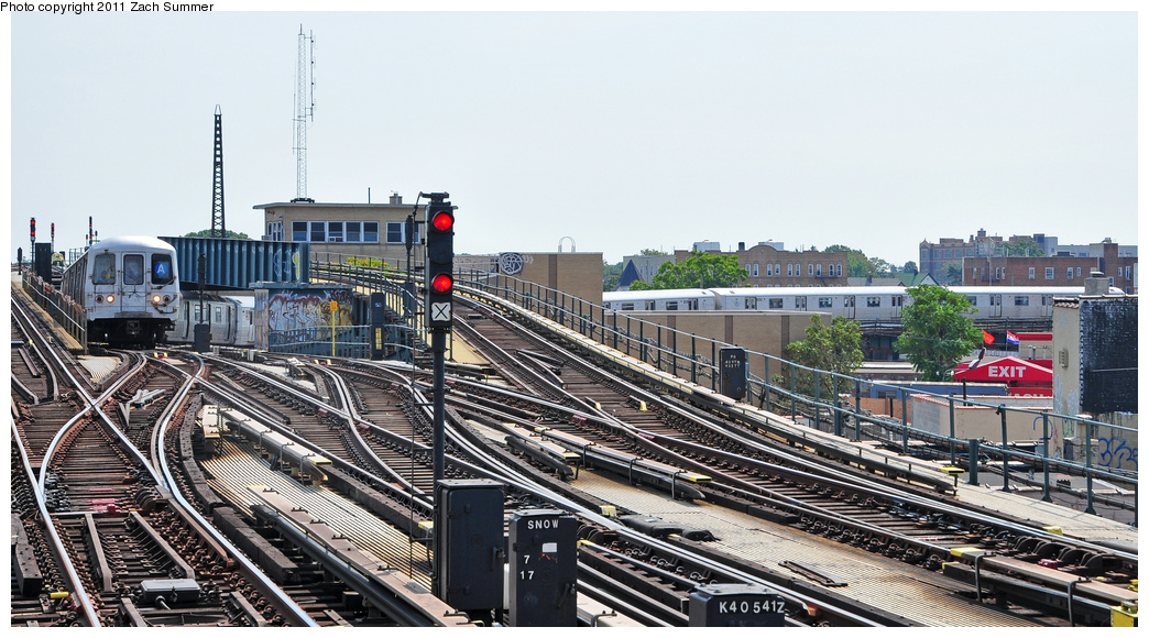 (358k, 1044x580)<br><b>Country:</b> United States<br><b>City:</b> New York<br><b>System:</b> New York City Transit<br><b>Line:</b> IND Fulton Street Line<br><b>Location:</b> Rockaway Boulevard<br><b>Route:</b> A<br><b>Car:</b> R-46 (Pullman-Standard, 1974-75) 6150 <br><b>Photo by:</b> Zach Summer<br><b>Date:</b> 7/23/2011<br><b>Viewed (this week/total):</b> 0 / 1610