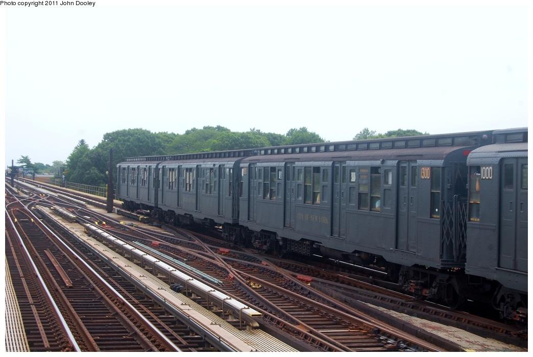 (261k, 1044x701)<br><b>Country:</b> United States<br><b>City:</b> New York<br><b>System:</b> New York City Transit<br><b>Line:</b> IND Fulton Street Line<br><b>Location:</b> 80th Street-Hudson Street<br><b>Route:</b> NT<br><b>Car:</b> R-6-1 (Pressed Steel, 1936) 1300 <br><b>Photo by:</b> John Dooley<br><b>Date:</b> 7/23/2011<br><b>Viewed (this week/total):</b> 1 / 948