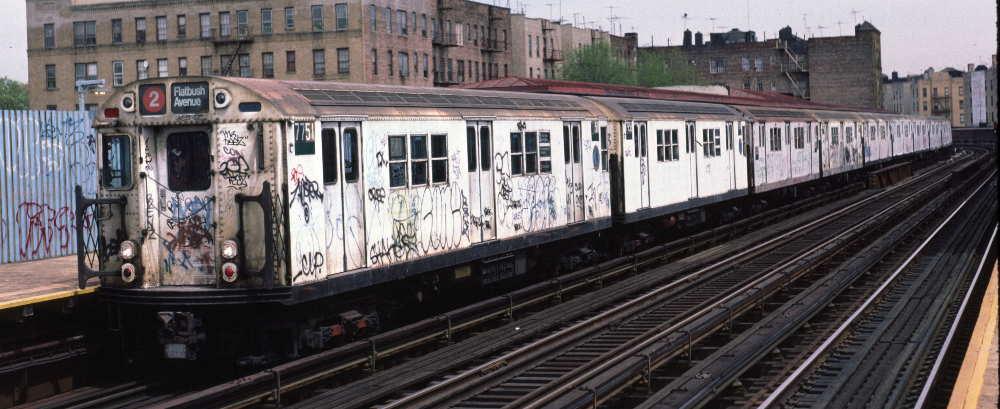 (65k, 1000x409)<br><b>Country:</b> United States<br><b>City:</b> New York<br><b>System:</b> New York City Transit<br><b>Line:</b> IRT White Plains Road Line<br><b>Location:</b> Bronx Park East<br><b>Route:</b> 2<br><b>Car:</b> R-26 (American Car & Foundry, 1959-60) 7751 <br><b>Photo by:</b> Robert Callahan<br><b>Date:</b> 4/1985<br><b>Viewed (this week/total):</b> 1 / 1401