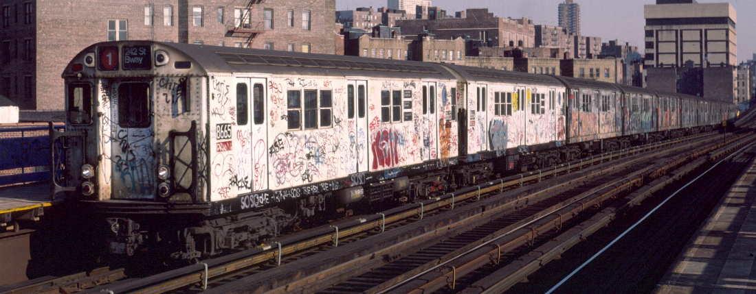 (69k, 1100x429)<br><b>Country:</b> United States<br><b>City:</b> New York<br><b>System:</b> New York City Transit<br><b>Line:</b> IRT West Side Line<br><b>Location:</b> 207th Street<br><b>Route:</b> 1<br><b>Car:</b> R-29 (St. Louis, 1962) 8665 <br><b>Photo by:</b> Robert Callahan<br><b>Date:</b> 2/16/1985<br><b>Viewed (this week/total):</b> 0 / 1286