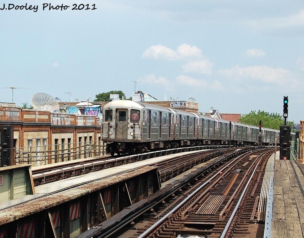 (415k, 1024x803)<br><b>Country:</b> United States<br><b>City:</b> New York<br><b>System:</b> New York City Transit<br><b>Line:</b> IRT Flushing Line<br><b>Location:</b> 52nd Street/Lincoln Avenue<br><b>Route:</b> 7<br><b>Car:</b> R-62A (Bombardier, 1984-1987) 1815 <br><b>Photo by:</b> John Dooley<br><b>Date:</b> 6/27/2011<br><b>Viewed (this week/total):</b> 1 / 1410