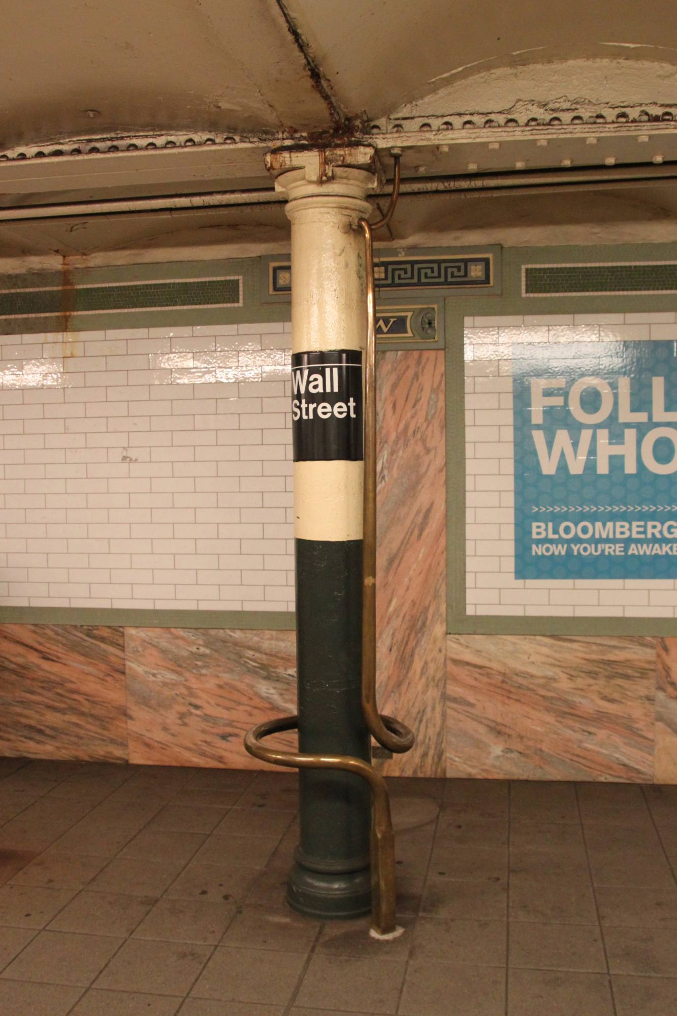 (241k, 1333x2000)<br><b>Country:</b> United States<br><b>City:</b> New York<br><b>System:</b> New York City Transit<br><b>Line:</b> IRT East Side Line<br><b>Location:</b> Wall Street<br><b>Photo by:</b> Robbie Rosenfeld<br><b>Date:</b> 9/25/2011<br><b>Artwork:</b> <i>Lariat Seat Loops</i>, James Garvey, 1997<br><b>Viewed (this week/total):</b> 3 / 2610