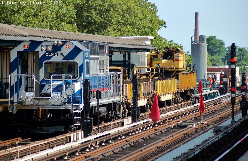(449k, 1024x668)<br><b>Country:</b> United States<br><b>City:</b> New York<br><b>System:</b> New York City Transit<br><b>Line:</b> BMT West End Line<br><b>Location:</b> Bay 50th Street<br><b>Route:</b> Work Service<br><b>Car:</b> R-156 Diesel-Electric Locomotive (MPI, 2012-2013) 912 <br><b>Photo by:</b> John Dooley<br><b>Date:</b> 7/29/2012<br><b>Viewed (this week/total):</b> 1 / 1966
