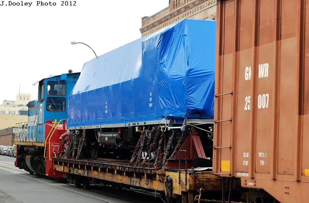 (307k, 1024x671)<br><b>Country:</b> United States<br><b>City:</b> New York<br><b>System:</b> New York City Transit<br><b>Line:</b> South Brooklyn Railway<br><b>Location:</b> SBK Yard (2nd Ave at 38th St.) (SBK)<br><b>Car:</b> R-156 Diesel-Electric Locomotive (MPI, 2012-2013) 912 <br><b>Photo by:</b> John Dooley<br><b>Date:</b> 5/1/2012<br><b>Notes:</b> En route from Bush Terminal to Linden Yd<br><b>Viewed (this week/total):</b> 2 / 2449
