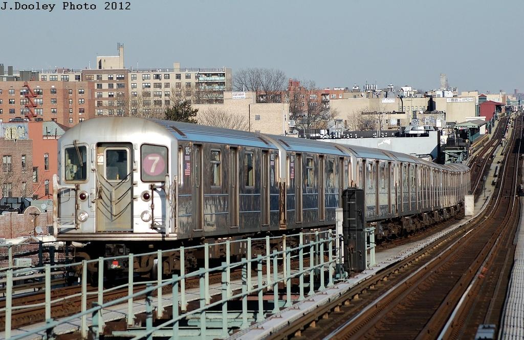 (365k, 1024x665)<br><b>Country:</b> United States<br><b>City:</b> New York<br><b>System:</b> New York City Transit<br><b>Line:</b> IRT Flushing Line<br><b>Location:</b> 61st Street/Woodside<br><b>Route:</b> 7<br><b>Car:</b> R-62A (Bombardier, 1984-1987) 1815 <br><b>Photo by:</b> John Dooley<br><b>Date:</b> 3/6/2012<br><b>Viewed (this week/total):</b> 0 / 1351