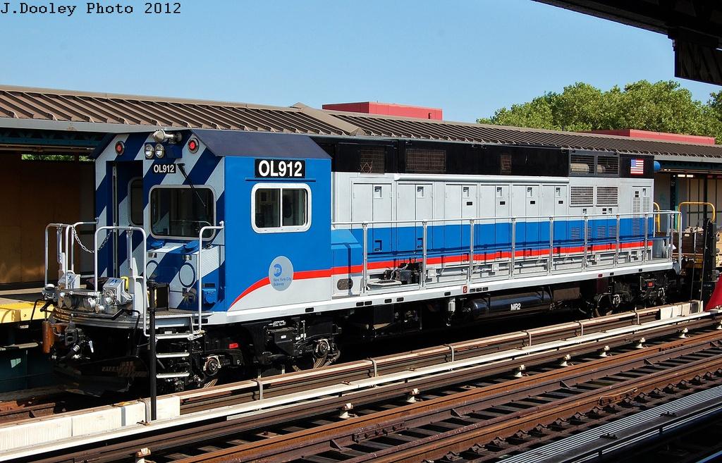 (375k, 1024x657)<br><b>Country:</b> United States<br><b>City:</b> New York<br><b>System:</b> New York City Transit<br><b>Line:</b> BMT West End Line<br><b>Location:</b> Bay 50th Street<br><b>Route:</b> Work Service<br><b>Car:</b> R-156 Diesel-Electric Locomotive (MPI, 2012-2013) 912 <br><b>Photo by:</b> John Dooley<br><b>Date:</b> 7/29/2012<br><b>Viewed (this week/total):</b> 0 / 2199