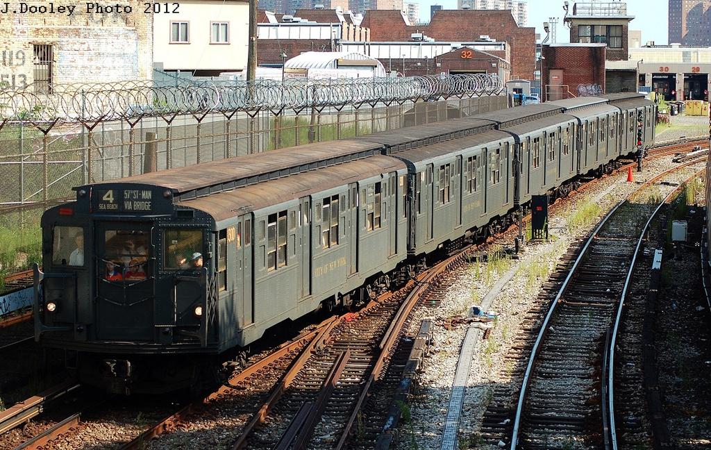 (469k, 1024x648)<br><b>Country:</b> United States<br><b>City:</b> New York<br><b>System:</b> New York City Transit<br><b>Line:</b> BMT Sea Beach Line<br><b>Location:</b> 86th Street<br><b>Route:</b> Transit Museum Nostalgia Train<br><b>Car:</b> R-6-1 (Pressed Steel, 1936) 1300 <br><b>Photo by:</b> John Dooley<br><b>Date:</b> 7/29/2012<br><b>Viewed (this week/total):</b> 0 / 3465