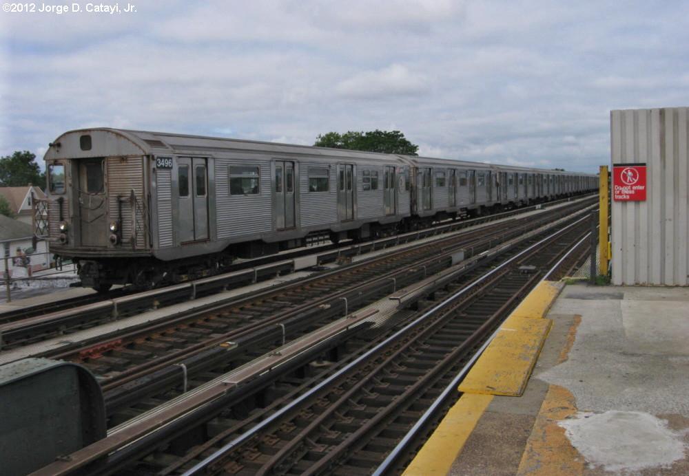 (171k, 1000x692)<br><b>Country:</b> United States<br><b>City:</b> New York<br><b>System:</b> New York City Transit<br><b>Line:</b> IND Fulton Street Line<br><b>Location:</b> Rockaway Boulevard<br><b>Route:</b> A<br><b>Car:</b> R-32 (Budd, 1964) 3496 <br><b>Photo by:</b> Jorge Catayi<br><b>Date:</b> 7/29/2012<br><b>Viewed (this week/total):</b> 1 / 1497